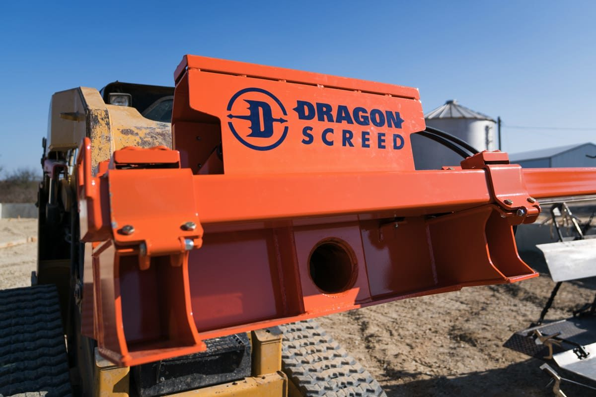 Dragon Screed, is a concrete power screed that is attached to a skid steer. The main body has a hydraulic pivot, allowing the user to adjust the tilt of the unit as they are leveling the concrete or gravel.