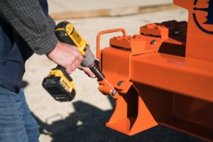 Concrete finisher uses a cordless drill to change the orientation of the Dragon Screed - switching from offset operation to inline operation. This type of concrete power screed is best for pouring parking lots and driveways.