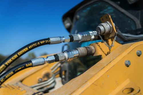 Our concrete power screed attachment features hydraulic hoses that plug into the front of a skid steer, allowing you to control the screed from your machine.