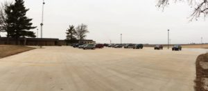 A concrete parking lot that was poured using Dragon Screed, a vibrating concrete screed that attaches to a skid steer