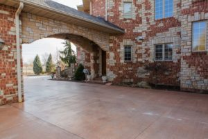 This beautiful concrete driveway was poured with a Dragon Screed.