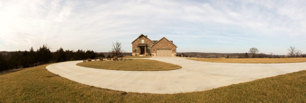 A concrete driveway with a turnabout was poured with vibrating concrete screed.