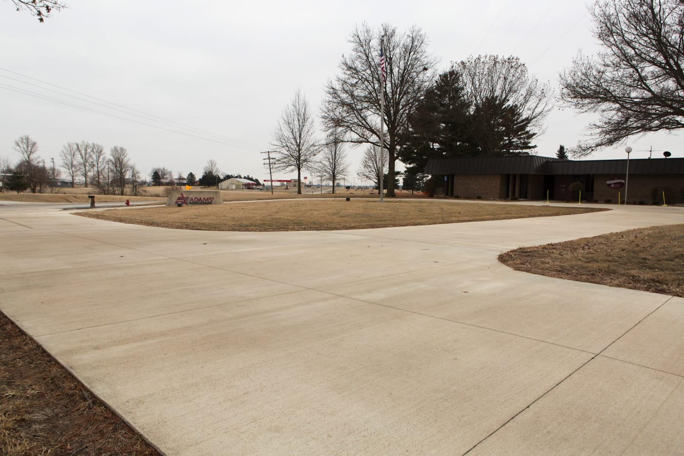 a concrete drive and parking lot that was poured using a vibrating concrete screed.