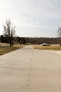 A concrete driveway that poured with a Dragon Screed. Dragon Screed is a vibrating concrete screed that levels concrete easily because it attaches to a skid steer or similar machine.