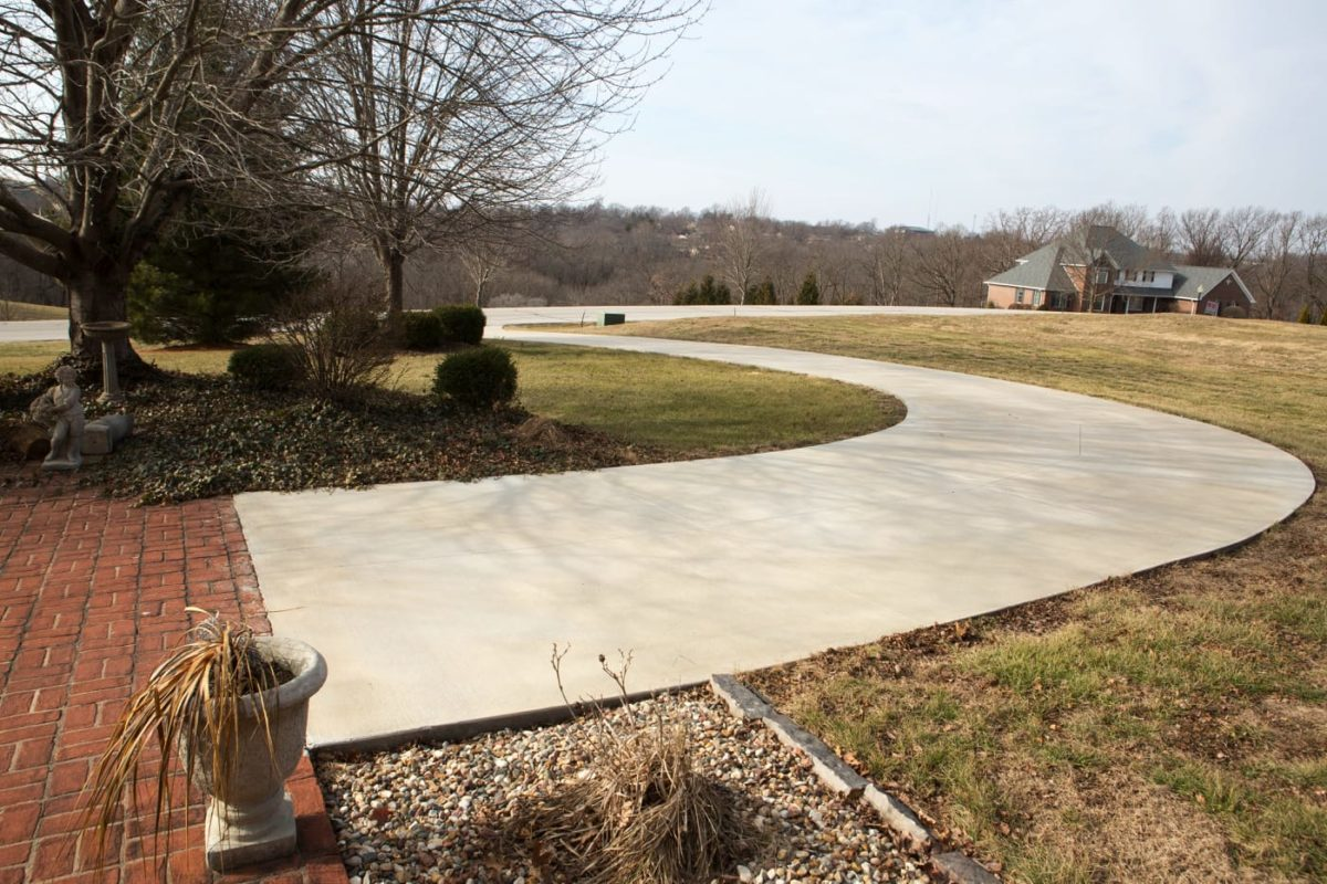 A long, flat, concrete driveway poured with a vibrating concrete screed.