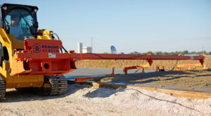 Vibrating concrete screeds for sale by Dragon Screed. These screeds level concrete and grade gravel by attaching to a machine and utilizing it's power.