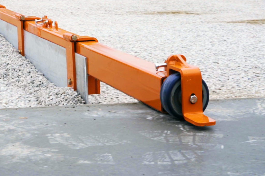 An adjustable wheel at the end of the vibrating concrete screed bar allows Dragon Screed to protect the previously poured concrete slab from scratching.