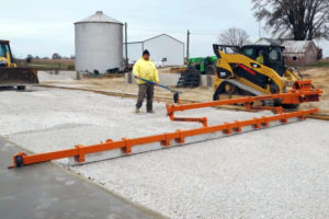 Dragon Screed leveling gravel base in reverse. It can also screed concrete in and level subgrade in forward mode as well.