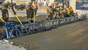 A Truss Screed is used to level freshly poured concrete. Truss screeds are arguably the best concrete screed type for use when pouring extremely wide slabs of concrete.