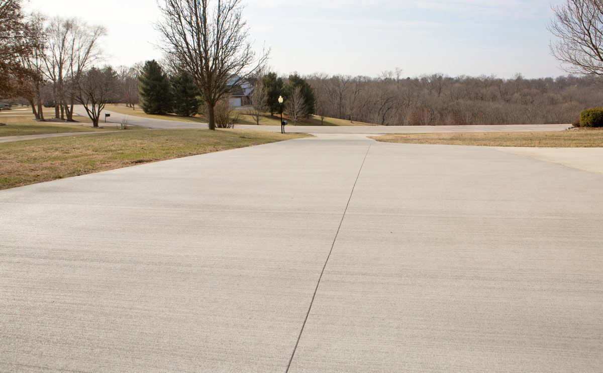 A beautiful new concrete driveway is the perfect example of how flat concrete can be when a contractor uses the best screed equipment available.