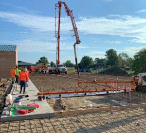 A crew prepares to pour a large slab of concrete.